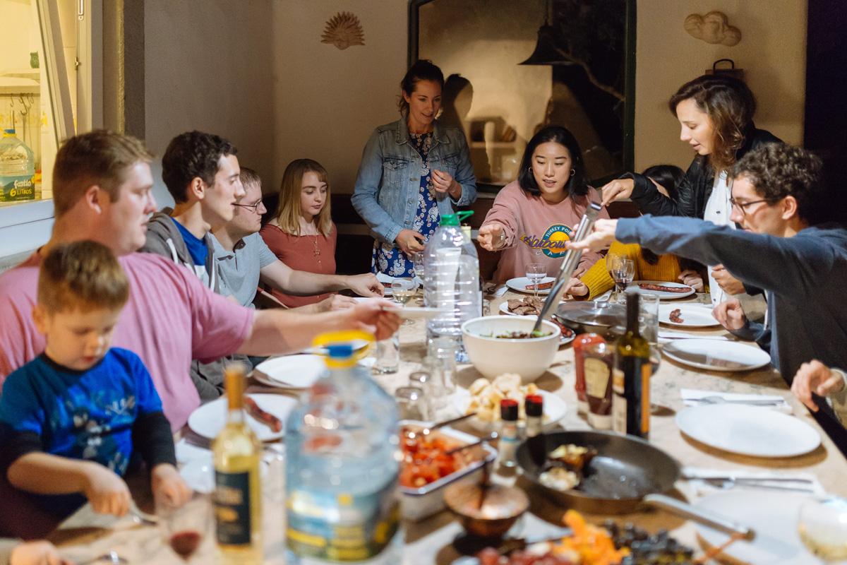 Family enjoying dinner in new house